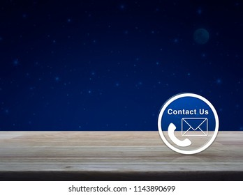 Telephone and email icon button on wooden table over fantasy night sky and moon, Busimess contact us concept