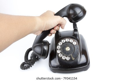 telephone, A hand pick up black retro telephone.