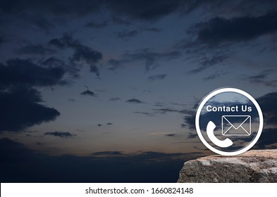 Telephone and mail flat icon button on rock mountain over sunset sky, Business contact us concept