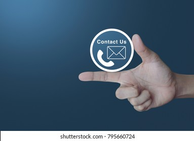 Telephone and mail icon button on finger over light gradient blue background, Contact us concept