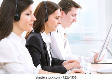 Telephone operators working in an office