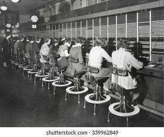 Telephone operators working on an international switchboard in the 1930s.
