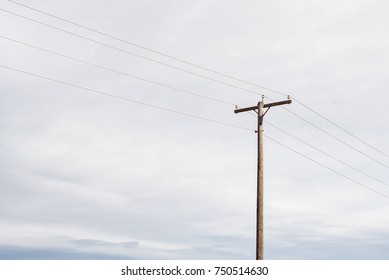 Telephone Pole in front of Cloudy Sky