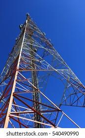 Telephone pole on blue sky