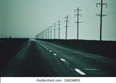 Telephone poles running along roadside