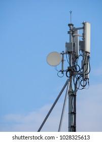 Telephone semaphore on blue sky background. Technology object.