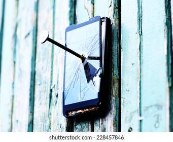 telephone tacked on a fence