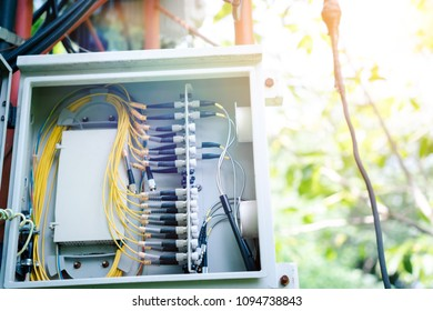 Telephone transmitter connection system at cellular phone antennas.Mobile telephone network base station.Control box.Development communication system.Connection of Cable Internet and Fiber Optic.