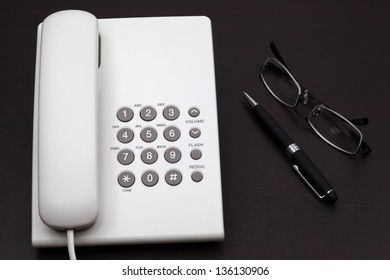 telephone white on a table
