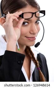 Telephonist raising her glasses