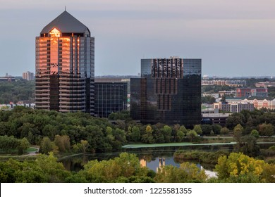 A Telephoto Close Up Shot on a Bloomington, Minnesota Office Park Reflecting Colors over Normandale Lake during a Summer Sunset