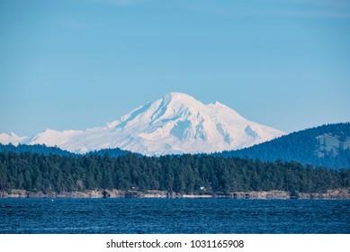Telephoto closeup image of snow capped Mt. Baker, Cascade Range, Washington, USA