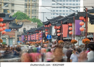 Telephoto image of many people on Chinese street. Shopping street in Shanghai.