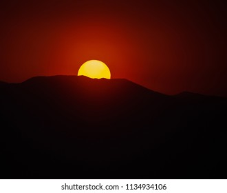 telephoto image of a smoky sunset with copy space