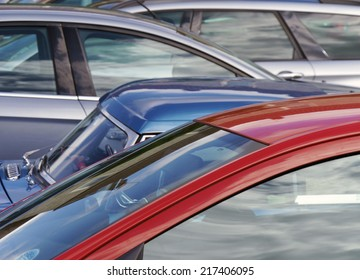 Telephoto view of cars parked in city center