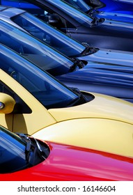 Telephoto view of cars parked on parking lot