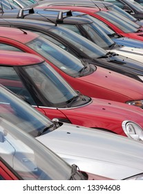 Telephoto view of cars in parking lot
