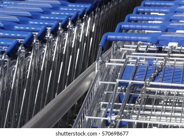 Telephoto view of rows of supermarket trolleys