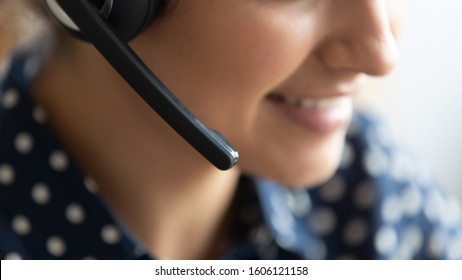 Telesales agent wear wireless headset microphone consult customer support service on phone call center concept, business woman operator receptionist telephone assistant representative close up view