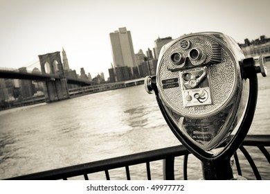 telescope before Skyline of New York City with Brooklyn Bridge, East River - vintage monochrome