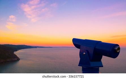 Telescope by the coast in Babbacome, Torquay, Devon