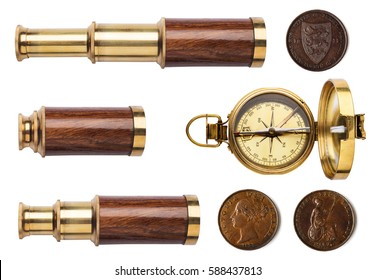 Telescope, compass, and old coins isolated on white background