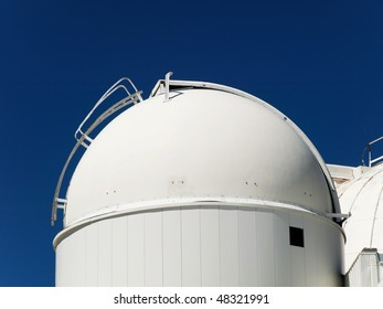 Telescope dome observatory under pure blue sky