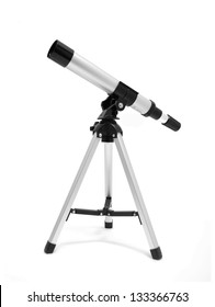 Telescope on tripod over white