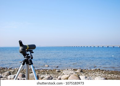 Telescope on a tripod for watching waterfowl by the Oland Bridge in Sweden