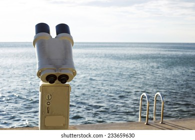 A telescope is ready for use, to observe the ocean.