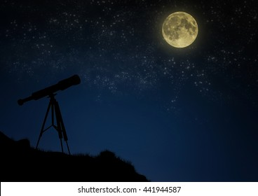 The telescope stands on a hill on a background of the night sky with a full moon