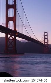 Telescope view of Golden gate bridge in evening, San Francisco bay, California, USA