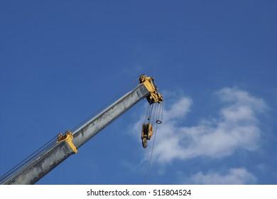 Telescopic Arm of a Mobile Crane against Blue Sky