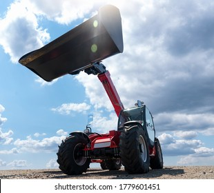 Telescopic loader against the blue sky