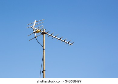 television antenna with blue sky background.