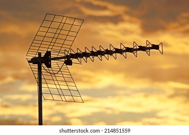 television antennas with a cloudy sky background