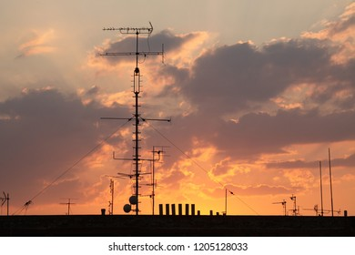 Television antennas on the roof pictured at sunset in Prague, Czech Republic.