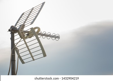 Television antennas with sky background. Analog television antenna on roof. Antennae for digital TV and radio reception. Mobile communication antennas at sunset.