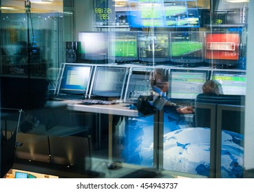 Television blurred background, news studio control panel with monitors through the glass