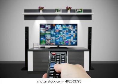 Television broadcast multimedia composition in room and remote control. Tv screen video broadcast internet concept