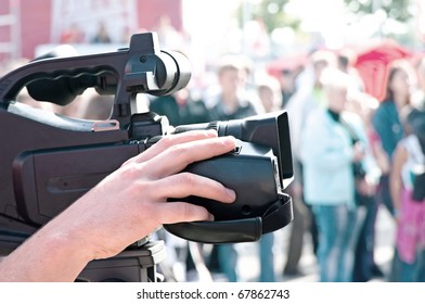 Television camera man filming a political rally