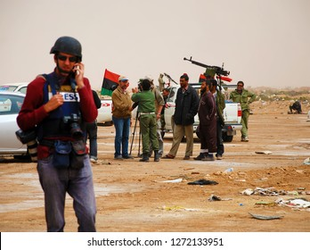 A television crew and a photo reporter make reports from a camp of rebels from the anti-Gaddafi coalition. Ajdabiya, Libya, April 7, 2011.