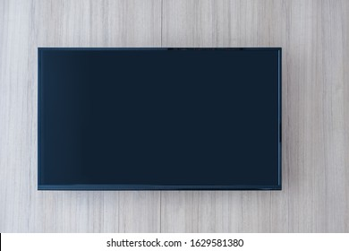 Television monitor with space for text or and advertising concept and modern wooden wall