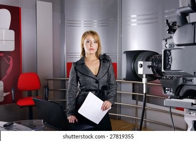 television news reporter in front of the video camera in studio in live transmission