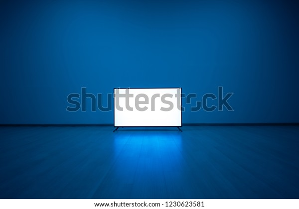 The television on the floor with a blue light background