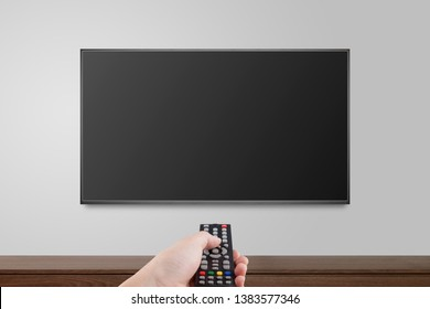 Television on white wall with hand using remote control, TV 4K flat screen lcd or oled, plasma realistic illustration, Black blank HD monitor mockup, Modern video panel black flatscreen.