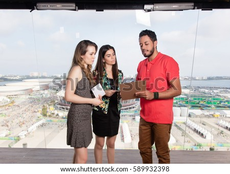 Television Producer Giving Instructions Female Presenters Stock