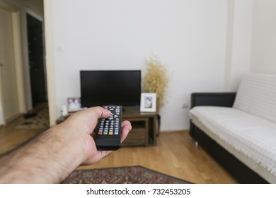 television remote control and hand