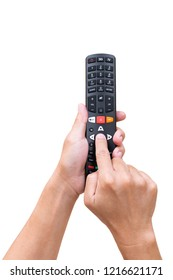 Television remote control in hand and press on white background