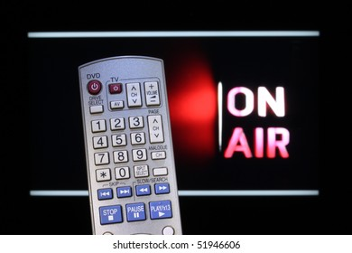 Television remote control and TV with On-Air sign.